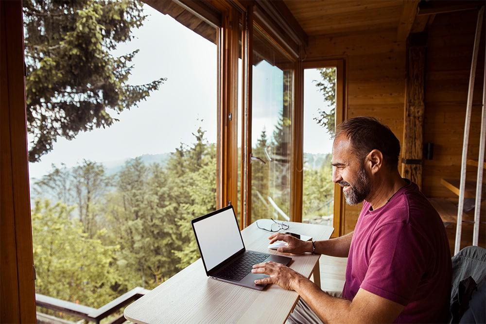 Man on computer in Newton, IA
