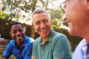 Three men discussing tinnitus